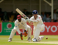 Photo. Glyn Thomas. <br /> England v West Indies. Second Test, nPower Test Series.<br /> Day 2. 30/07/2004.<br /> Ashley Giles (R) sweeps a delivery from Omari Banks as wicket keeper Ridley Jacobs looks on.