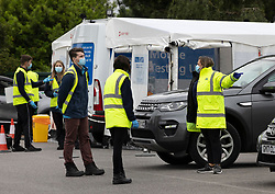 © Licensed to London News Pictures. 19/06/2021. Tattenham Corner, UK. Staff get ready to receive local residents at a mobile covid-19 test centre at Tattenham Corner, Surrey. Surge testing for the coronavirus is taking place in parts of Surrey after a rise in infections caused by the delta variant. Photo credit: Peter Macdiarmid/LNP