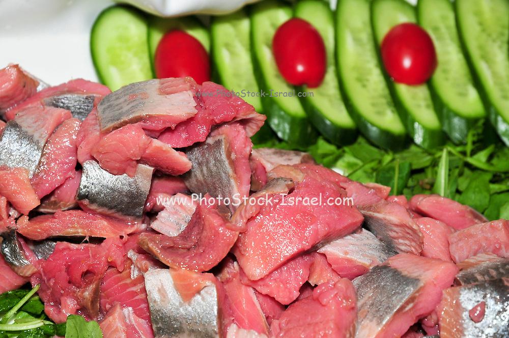 A platter of herring slices