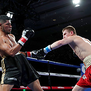 Ivan Golub (R) fights Luis Florez during a One For All Promotions boxing event at the Caribe Royale Orlando Events Center on Saturday, February 20, 2021 in Orlando, Florida. (Alex Menendez via AP)
