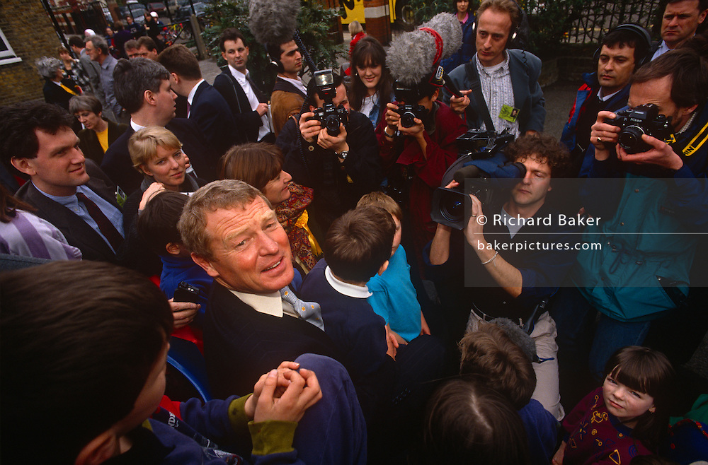 Surrounded by media is Liberal Democrat leader Paddy Ashdown while campaigning in Richmond, on 17th March 1992 in London, England. With a total of 22 seats won (22.6%  of the vote),  the 'Lib Dems' came third in the '92 election after the re-election victory by John Major's Conservatives.