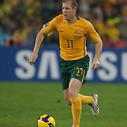 Scott Chipperfield in action during the 2010 Fifa World Cup Asian Qualifying match between Australia and Uzbekistan at Stadium Australia in Sydney, Australia on April 01, 2009. Australia won the match 2-0.  Photo Tim Clayton