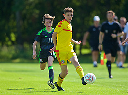WREXHAM, WALES - Monday, July 22, 2019: Sebastian Watkins of South during the Welsh Football Trust Cymru Cup 2019 at Colliers Park. (Pic by Paul Greenwood/Propaganda) Harvey Morris of North