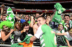 Yeovil Town's Kevin Dawson celebrates winning the League One Play Off Final with fans - Photo mandatory by-line: Joe Meredith/JMP - Tel: Mobile: 07966 386802 19/05/2013 - SPORT - FOOTBALL - LEAGUE 1 - PLAY OFF - FINAL - Wembley Stadium - London - Brentford V Yeovil Town