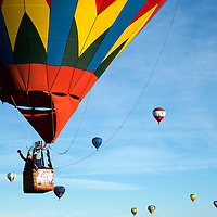 A balloonist and rider join the other hot air balloons in the sky taking off during the Farewell Ascension of the Albuquerque International Balloon FiestaSunday. Hundreds of hot air balloon enthusiasts participated in this week long event.