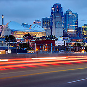 Kansas City Missouri skyline at dusk with car traffic motion blur in foreground