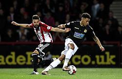 Kaiyne Woolery of Bolton Wanderers goes past Yoann Barbet of Brentford - Mandatory by-line: Robbie Stephenson/JMP - 05/04/2016 - FOOTBALL - Griffin Park - Brentford, England - Brentford v Bolton Wanderers - Sky Bet Championship