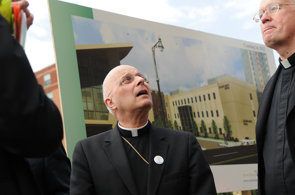 Archbishop Francis Cardinal George surveys the future site of an expanding Old St. Mary's Catholic School in Chicago's South Loop neighborhood.