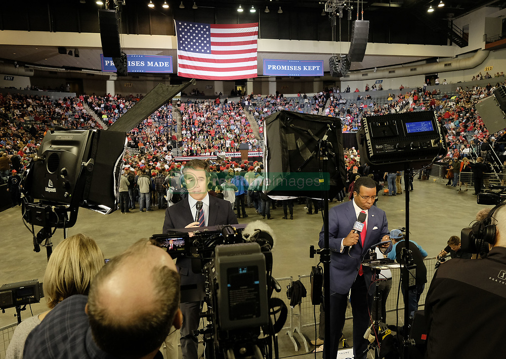 October 9, 2018 - Council Bluffs, Iowa, U.S. - National network correspondents NBC's PETER ALEXANDER, left, and Fox's KEVIN CORKE, right, do stand ups for their nightly news reports while waiting President Donald Trump (R) to addresse attendees at a campaign Make America Great Again rally at the Mid-America Center. (Credit Image: © Jerry Mennenga/ZUMA Wire)