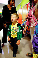 Mason Farley walks to class on the first day of school at Melrose Leadership Academy in Oakland, California.