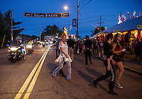Bike and visitors head down Lakeside Avenue Friday evening for Bike Week.  (Karen Bobotas/for the Laconia Daily Sun)