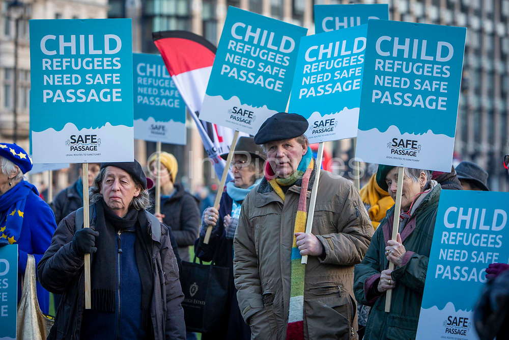 Award winning author Sir Michael Morpurgo joins supporters of the Child Refugee charity Safe Passage calling on Peers in the House of Lords to back an amendment and uphold refugee family reunion on the 20th of January 2020 in Parliament Square, Westminster, London, United Kingdom. 95% of the children currently receiving legal support from the charity Safe Passage International to reunite with relatives in the UK would not be eligible for family reunion under current UK Immigration Rules.