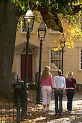 Newport, RI - three girls walk though Washington square park with fall colors.