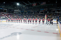 KELOWNA, CANADA - SEPTEMBER 20: The Kelowna Rockets stand not the blue line during the national anthem on the home opening regular season game against the Kamloops Blazers on September 20, 2014 at Prospera Place in Kelowna, British Columbia, Canada.   (Photo by Marissa Baecker/Shoot the Breeze)  *** Local Caption ***