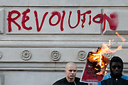 Revolution is painted on the wall of a government building in Whitehall during a student protest