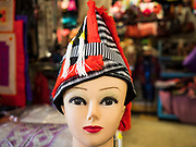 03 AUGUST 2019 - ST. PAUL, MINNESOTA: A Hmong style hat on a mannequin in the Hmongtown Marketplace. Thousands of Hmong people, originally from the mountains of central Laos, settled in the Twin Cities in the late 1970s and early 1980s. Most were refugees displaced by the American war in Southeast Asia. According to the 2010 U.S. Census, there are now 66,000 ethnic Hmong in the Minneapolis-St. Paul area, making it the largest urban Hmong population in the world. There are two large Hmong markers in St. Paul. The Hmongtown Marketplace has are more than 125 shops, 11 restaurants, and a farmers' market in the summer. Hmong Village is newer and has more than 250 shops and 17 restaurants.     PHOTO BY JACK KURTZ
