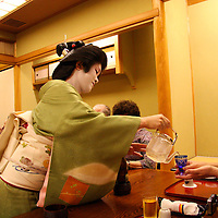 Asia, Japan, Kyoto. Geisha entertaining dinner guests at private event in Kyoto.