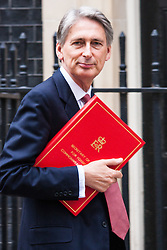 London, August 12th 2014. Foreign Affairs secretary Philip Hammond arrives at 10 Downing Street to chair a COBR meeting discussing thelates developments in Iraq's stuggle against the IS onslaught.