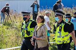 West Hyde, UK. 14th September, 2020. Hertfordshire Police arrest an environmental activist from HS2 Rebellion who, together with another activist, had used a lock-on arm tube to block a gate to the South Portal site for the HS2 high-speed rail link. Anti-HS2 activists blocked two gates to the same works site for the controversial £106bn rail line, one remaining closed for over six hours and another for over nineteen hours.