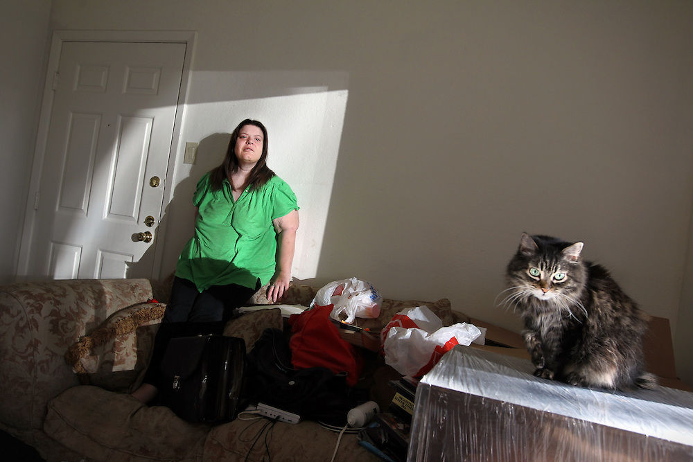 Michelle Cohen and her cat, Blossom, photographed at her Dallas apartment Thursday January 7, 2010.  The bank that oversees Cohen's trust fund is attempting to have her declared incompetent. She suffers from mental illness, yet has been on her own for most of her life. She's terrified she'll lose the right to spend her own money and control her own life.