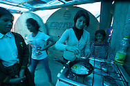 Lima, Peru. Jicamarca. Teresa Sedano Unocc in the dining room of  her home wth her three sisters.