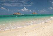 The Mokulua Islands off Lanikai Beach on the island of Oahu, Hawaii.