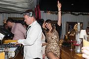PETE TONG; CAROLINA TONG, Pete & Carolina Tong and Yasmin Mills Christmas Party. Baroque, The Playboy Club, Old Park Lane, London. 15 December 2012.