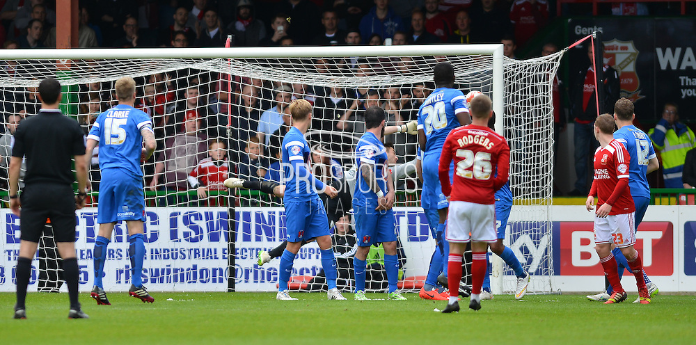 Swindon Town's Anton Rodgers scores free kick during the Sky Bet League 1 match between Swindon Town and Leyton Orient at the County Ground, Swindon, England on 3 May 2015. Photo by Mark Davies.