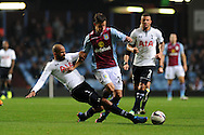 Aston Villa's Aleksandar Tonev is tackled by Tottenham's Sandro. Capital one cup 3rd round match, Aston Villa v Tottenham Hotspur at Villa Park in Birmingham on Tuesday 24th Sept 2013. pic by Andrew Orchard, Andrew Orchard sports photography.