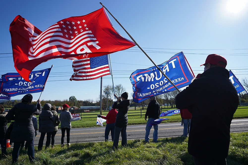 Supporters of President Donald Trump gather across from Dutch Springs, where Sen. Kamala Harris is appearing Nov. 2, 2020, for a drive-in rally in Bethlehem Township, Pennsylvania.
