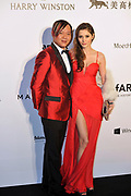 HONG KONG - MARCH 14:  Billionaire Stephen Hung and his wife Deborah Valdez-Hung arrive on the red carpet during the 2015 amfAR Hong Kong gala at Shaw Studios on March 14, 2015 in Hong Kong. Photo : Lucas Schifres/Abaca  (Photo by Lucas Schifres/Lucas Schifres)