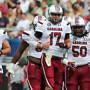 South Carolina Gamecocks quarterback Dylan Thompson (17) enters the field during an NCAA football game between the South Carolina Gamecocks and the Central Florida Knights at Bright House Networks Stadium on Saturday, September 28, 2013 in Orlando, Florida. Thompson replaced starting quarterback Connor Shaw who was injured in the first quarter. (AP Photo/Alex Menendez)