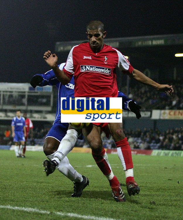 Photo: Paul Thomas.<br /> Oldham Athletic v Swindon Town. Coca Cola League 1.<br /> 10/12/2005.<br /> <br /> Swindon's Hameur Bouazza is under pressure by Terrell Forbes.