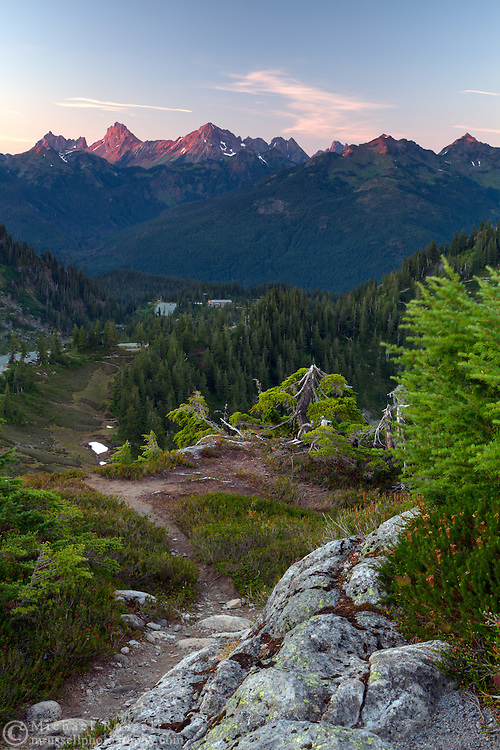 Alpenglow on Canadian Border Peak and American Border Peak from Artist Point at the Mount Baker-Snoqualmie National Forest, Washington State, USA.