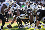 Oakland Raiders center Rodney Hudson (61) hikes the ball to Oakland Raiders quarterback Derek Carr (4) against the Tennessee Titans at Oakland Coliseum in Oakland, Calif., on August 26, 2016. (Stan Olszewski/Special to S.F. Examiner)