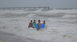 September 9, 2017 - Hollywood, FL, USA - Body surfers enter the waters of the Atlantic at Hollywood Beach as Hurricane Irma approaches on Saturday, Sept. 9, 2017, in Hollywood, Fla. (Credit Image: © Joe Cavaretta/TNS via ZUMA Wire)