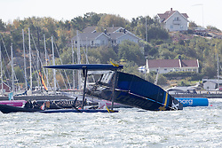 Ulysses Nardine presents a new watch on the official practice day before the ACWS Gothenburg. Artemis Racing. 28th of August, 2015, Gothenburg, Sweden