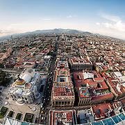 View looking north out over Mexico City from the 44th floor of the Torre Latinoamericana building. In the foreground is the distinctive Palacio de Bellas Artes.