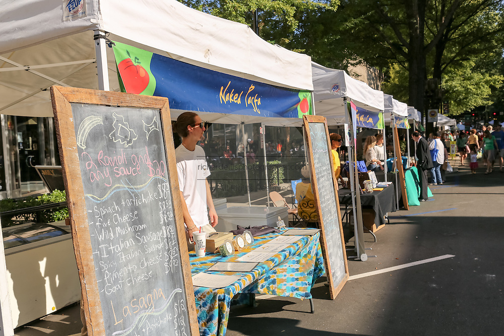 A vendor displays homemade products at the Farmers Market along Main Street in downtown Greenville, South Carolina.