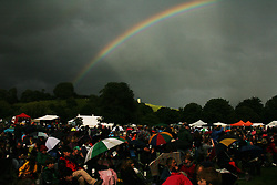 © Licensed to London News Pictures. 30/06/12. Glastonbury, UK. A rainbow seen over Glastonbury Tor. The Orchestra in the Field Event held at Glastonbury Abbey this weekend in Somerset as a torrential downpour hit on Saturday night. Photo credit : Jason Bryant/LNP