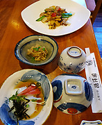 """Japanese breakfast. Tokusawa-en mountain hut is an easy walk of 7.5 km with 100 meters gain from Kamikochi. Kamikochi (""""Upper Highlands"""") is a high valley within the Hida Mountains, in Chubu-Sangaku National Park, Nagano Prefecture, Japan. Last logged in the mid 1800s, it is now a popular nature resort. Embraced within the """"Northern Alps"""" of the Japanese Alps, the valley floor ranges from 1400 m (4600 ft) to 1600 m (5200 ft) elevation. Its highest peak is Okuhotakadake (3190 m or 10,470 ft)."""
