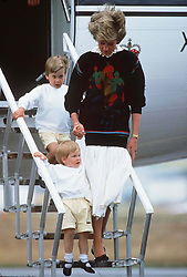 The Princess of Wales with her young sons Prince William and Harry arriving at Aberdeen airport for their holiday in Scotland in August 1986.<br /><br />Photo.  Anwar Hussein