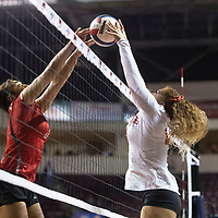 Pine Hill's Maurie Daniels (13), right, and Quemado's Ashanti Mathis both reach for the ball Friday morning at the Santa Ana Star Center in the NMAA Class 1A State Volleyball tournament in Rio Rancho.
