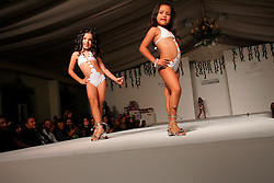 Contestants at the Pequeña Modelo de Venezuela beauty pageant. The pageant is for girls aged 6-10.  Beauty pageants for little girls are fairly common and very accepted in Venezuela. Girls aged 6-10 often spend months or years taking all sorts of beauty school classes, ranging from runway walking to makeup to etiquette. The families spend thousands of dollars on preparing their girls for the pageants ; they have to pay for beauty school classes, a competition entrance fee, dresses and many other expenses.  The world of beauty pageants is said to be very corrupt, where the highest bidder is the surest winner.