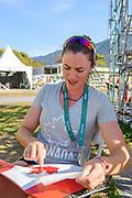 "Rio de Janeiro. BRAZIL.   2016 Olympic Rowing Regatta. Lagoa Stadium, Canadian Athlete Antje Von SEYDUTZ, prepares her Oar/Blade,  with the Maple Leaf, Motiff,<br /> Copacabana,  ""Olympic Summer Games""<br /> Rodrigo de Freitas Lagoon, Lagoa.   Sunday  07/08/2016 <br /> <br /> [Mandatory Credit; Peter SPURRIER/Intersport Images]"