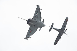 © Licensed to London News Pictures. 17/07/2015. RAF Fairford, UK. Battle of Britain Typhoon and Spitfire Pair, The Royal International Air Tattoo (RIAT). Photo credit : Ian Schofield/LNP