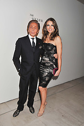 Fashion designer VALENTINO and ELIZABETH HURLEY at a private view of 'Valentino: Master Of Couture' at Somerset House, London on 28th November 2012.