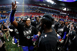Florida Gators players celebrate winning the Chick-fil-A Peach Bowl, Saturday, December 29, 2018, in Atlanta. ( Paul Abell via Abell Images for Chick-fil-A Peach Bowl)