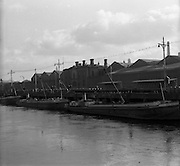 """05/03/1957<br /> Scenes on the Liffey River, Dublin at Guinness's Wharf, the Guinness barges, """"Killiney"""", """"Castleknock"""" and ? tied up outside the brewery."""