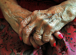EMBARGOED TO 0001 SATURDAY APRIL 29 File photo dated 05/12/08 of the hands of an elderly woman. Elderly social care, energy prices and financial fraud must be top priorities for the next government to maintain consumer confidence and a thriving economy, a watchdog has said.